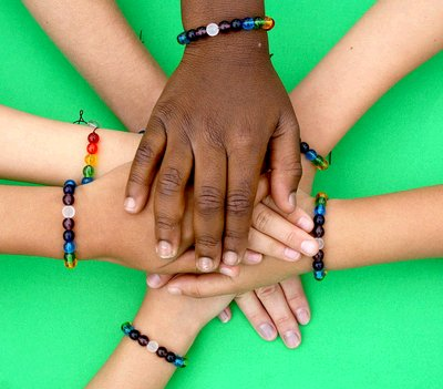 childrens hands wearing peace malas